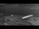German zeppellin Hindenburg (LZ-129) maneuvering to dock at US Naval Air Station, Stock Footage