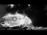 LZ-129 Hindenburg airship engulfed in flames crashes into ground at Lakehurst Nav...HD Stock Footage