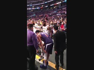 Devin booker walling over to the locker room after injuring himself chasing a loose ball.