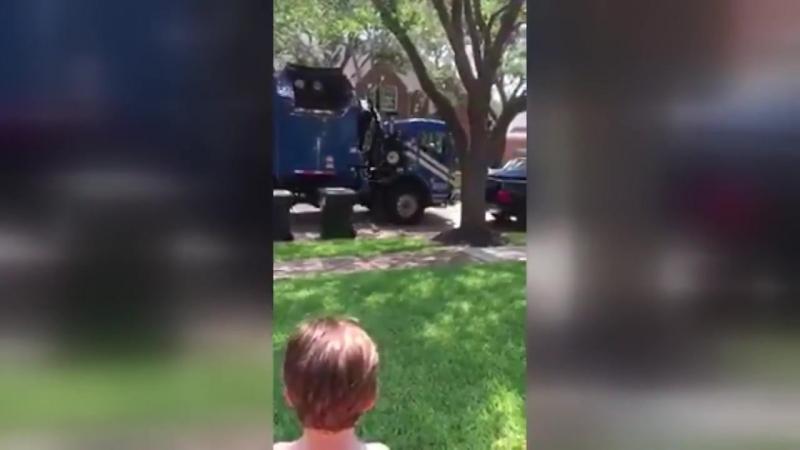 Kind Garbage Truck Driver Gives Boy a Gift __ ViralHog