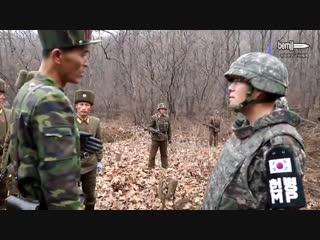 Historic at the DMZ South and North Korean soldiers shake hands - Two Koreas connect DMZ r