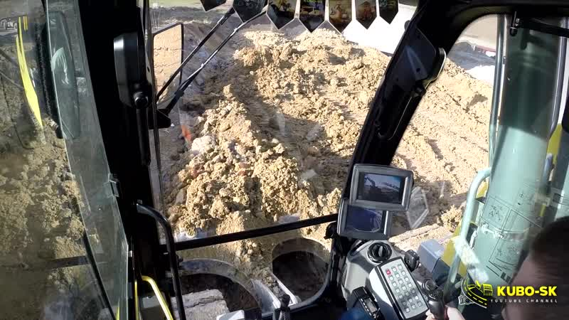 Liebherr R926 compact excavator pushing clay - cab view