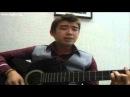 Парень-уйгур на гитаре