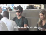 Exclusive Dylan O'Brien arrives at LAX airport in LA for a departing flight to NYC