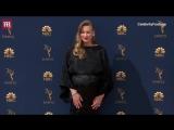 Yvonne Strahovski shows her baby bump on the Emmys red carpet