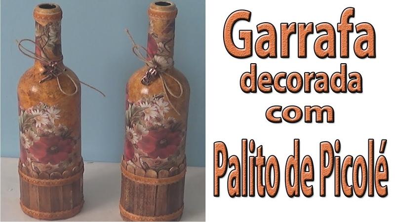 Garrafa decorada com palitos de picolé