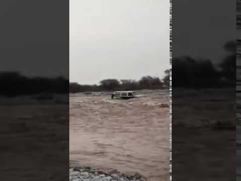 Man attempts to cross overflowing wadi in Oman during heavy rains, gets stuck