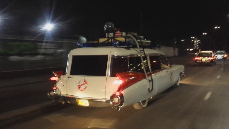 Escorting ECTO 1 with 5 American police cars