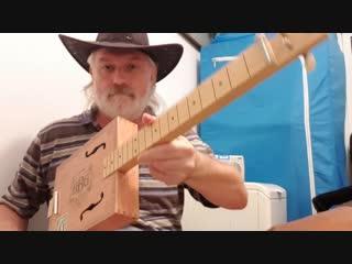 """""""sadness"""". cigar box guitar. d tune."""