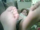 Soft, cute, beauty legs of a girl who lies on the couch and communicates with her little sister