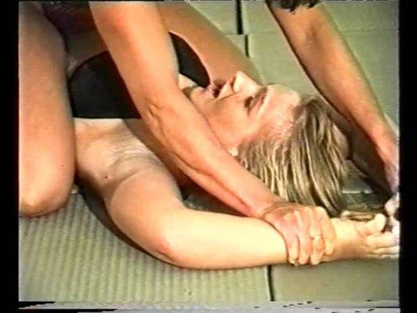 Women wrestling on the ground