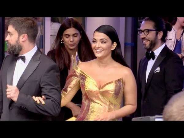 EXCLUSIVE Gorgeous Aishwarya Rai with an amazing golden dress comes out of the Palais backdoor ent
