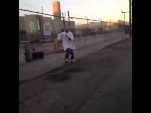Shaggy pants vato falls down on his ass while trying to RUN !! LOL