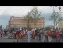 Чё делает футбол, а!   Кришнаиты сектанты, завывают напротив ФСБ :))