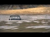 Land rover in Hogmoor pond - extreme wading in the deep bit. SLRC