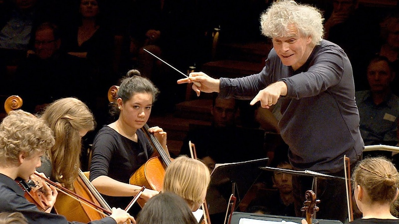 In rehearsal Simon Rattle conducts 6 Berlin school orchestras