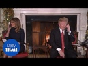 Donald and Melania Trump and take Christmas calls at the WH