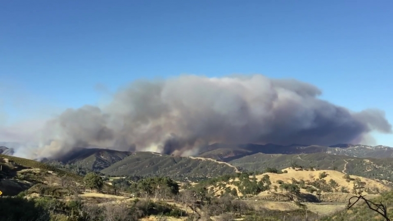 Pawnee Fire, Very Large Air Tanker-911 dropping on ridge line