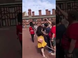 Queens guard pushes tourist in the back
