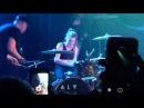 Lynn Gunn playing drums for K.Flay