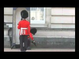 Buckingham Palace guard grins and bears it after fall