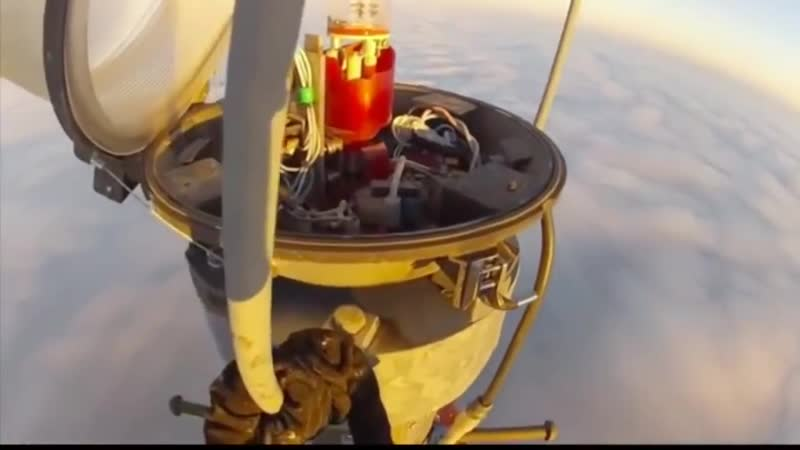 Changing a light bulb on top of a 2000ft mast, while the clouds are below you.