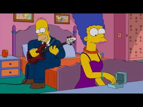 Гомер играет на бас гитаре