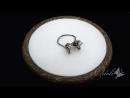 Серебряные серьги-гвоздики с муассанитами Голубой лед