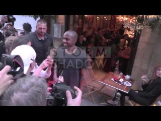 Kanye West had dinner at Ferdi in Paris. Kanye sign fake Yeezus shoes to a fan