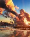 Как выглядит город мечты? Нужно взять высокотехнологичный небоскреб и огненный закат.