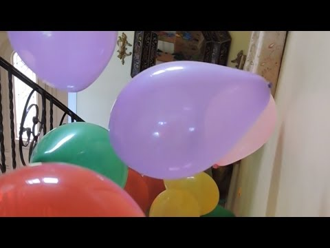 100 Balloons Tumble Down the Stairs