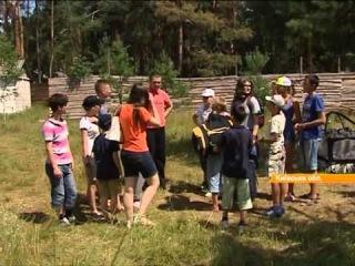 Армейские палатки и полевая кухня: Под Киевом в лагере нашли приют дети-беженцы с Востока