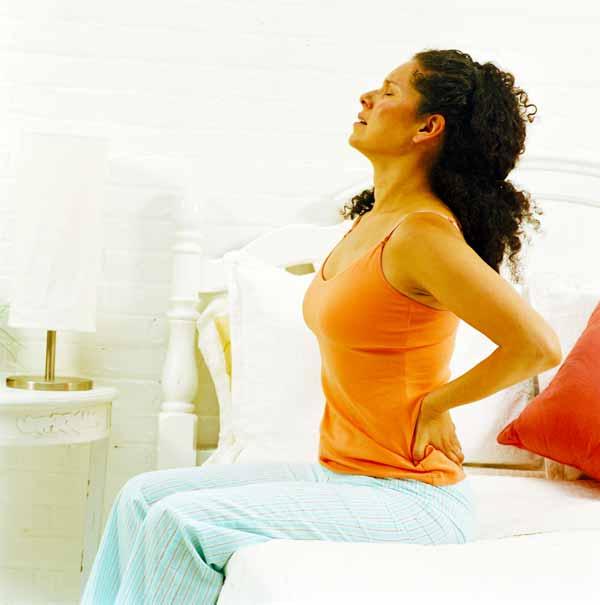 Что вызывает боль в пояснице на ранних сроках беременности?