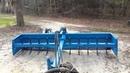Hydraulic box blade with tilt