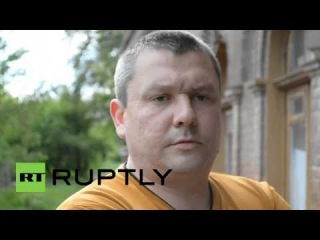 Ukraine: Young boy wearing St. George's ribbon shot in Slavyansk