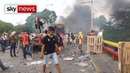 At least 300 hurt in Venezuela as protesters battle for food and medicine