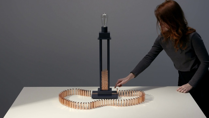 Glithero's interactive lamp is illuminated by a toppling row of dominoes