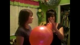 Two emo girls do the balloon challenge and blow to pop a balloon