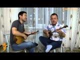 Японец Наоки Такахаши и Нуржан Жанпеисов исполняют на домбре казахскую песню