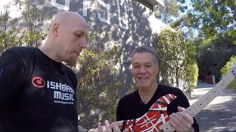 Eddie Van Halen autographs a guitar infront of 5150 Studio
