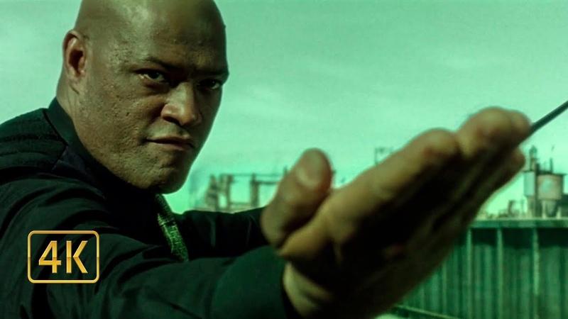 Морфеус защищает мастера ключей от Агента Бой на крыше фуры Матрица Перезагрузка 2003
