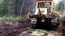 Caterpillar D7 F bulldozing logging road