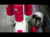 Watch raw man intentionally ignites fire at Staten Island BP gas pump.