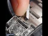 Ручная гравировка Rolex Submariner.