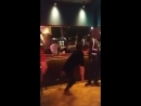 Drunk lad slips on dance floor and falls over in front of a bouncer