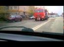 На улице Суворова около КАМАЗа сидит голый мужчина