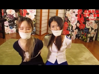 Two sexys chinese girls in white tape