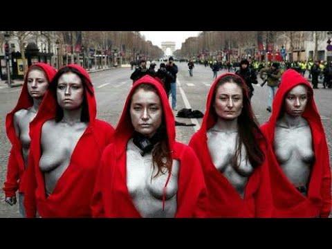 RlTUAL ALERT: 5 WOMEN IN RED ROBES IN FRONT OF ARC DE TRIOMPHE