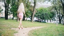Confident Walk in Mini Skirt and High Pink Heels