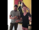 Gerard Butler is doing a magic trick with Rubik's Cube